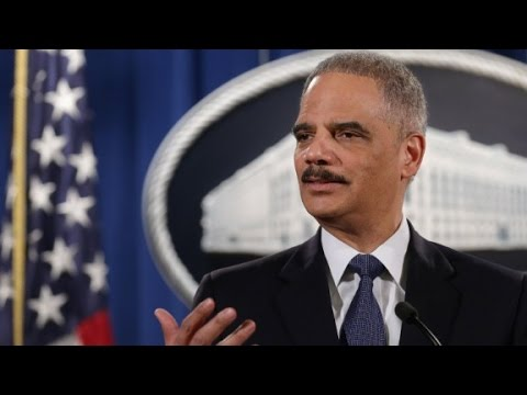 Holder: Ferguson police shooter a 'punk'