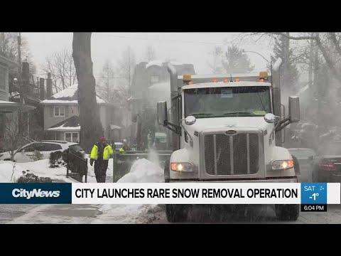 City Crews Begin Rare Snow Removal Operation
