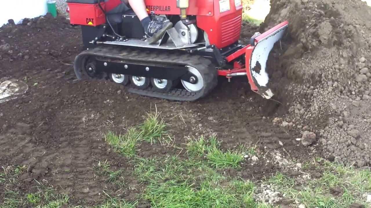 Mini Dozer Crawler Pushing Dirt Caterpillar Youtube