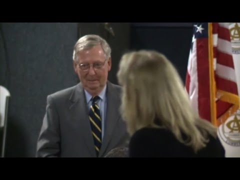 Woman berates McConnell at luncheon