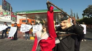 Protests and looting erupt in Mexico against gas price hike