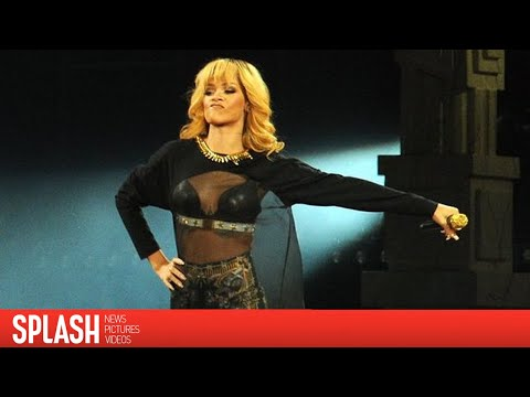 Rihanna Hits Fan in the Face with Microphone During UK Concert   Splash News TV