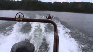 240 Bentley Pontoon   Maroon on water pulling tube fast