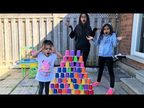 Kids pretend play Builds COLORFUL cup wall - funny kids video