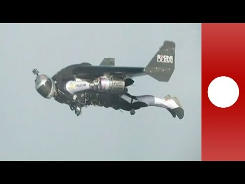 Jetmen Soar Over Dubai In Ironmanstyle Flying Suits YouTube - Crazy video of two guys flying jetpacks over dubai