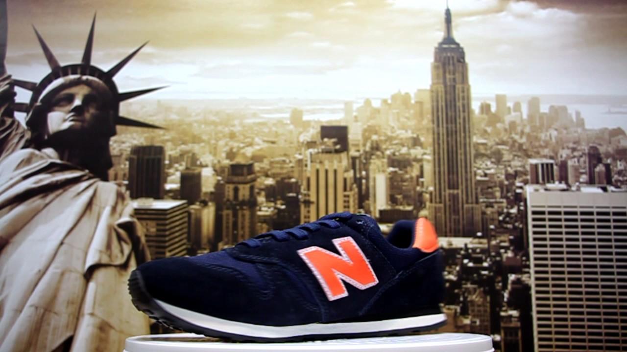 new balance 373 azul marinho e laranja