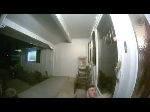 A.D. - Video: Guy Tries to Sneak Past the Front Door Security Cam