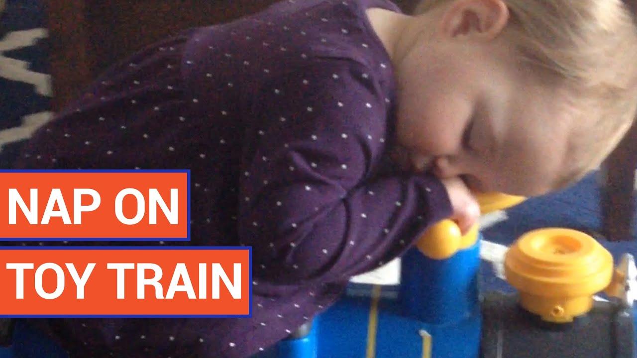 Little Girl Falls Asleep On Toy Train
