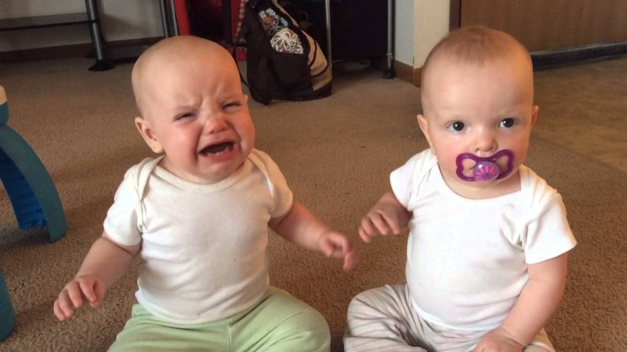 Twin baby girls fight over pacifier #1