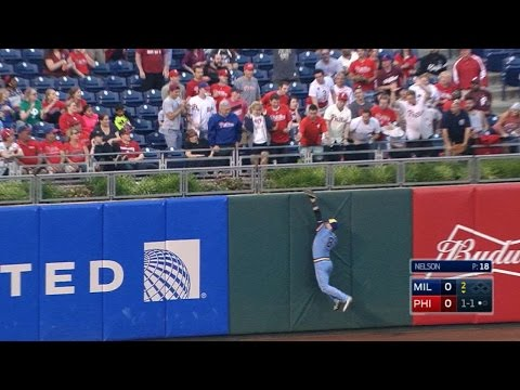 Braun makes a leaping catch at the wall