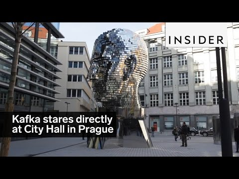 A sculpture of Franz Kafka's head faces City Hall in Prague