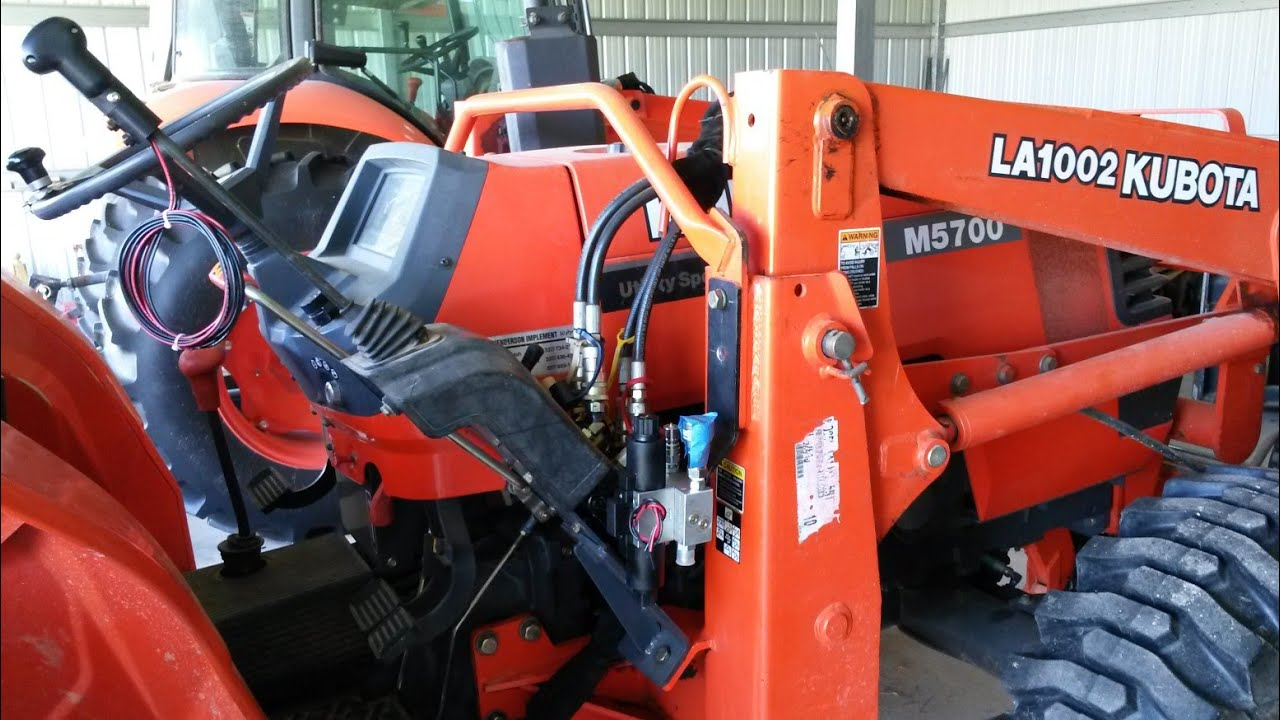 Kubota M5700 with LA1002 Loader Third Function for Grapple