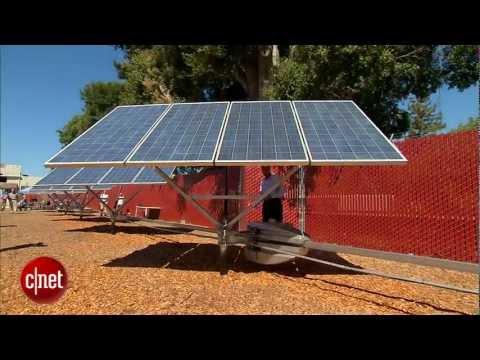 Robots pivot solar panels to face the sun