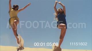 1970 Girls in shorts jumping on sand dunes buggies racing Stock Footage HD