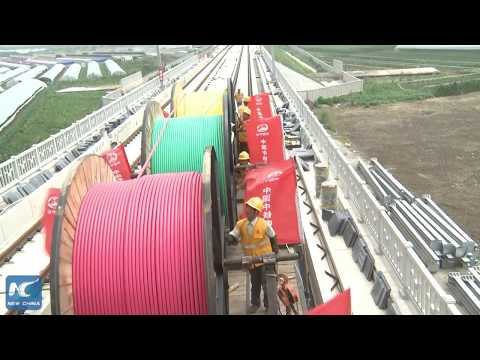 Unique cart lays power cables on high-speed rail track