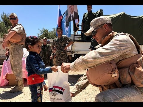 SYRIA: Russian servicemen distribute humanitarian aid in the province of Daraa