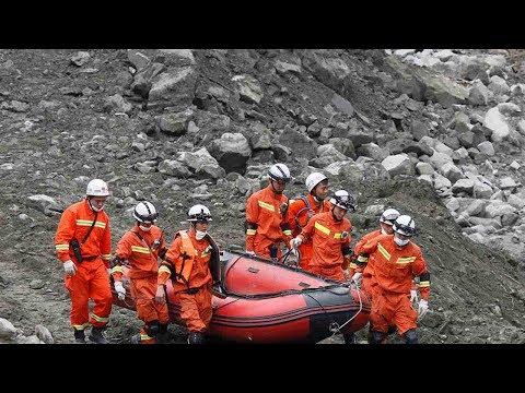 Rescuers race to find survivors days after China landslide
