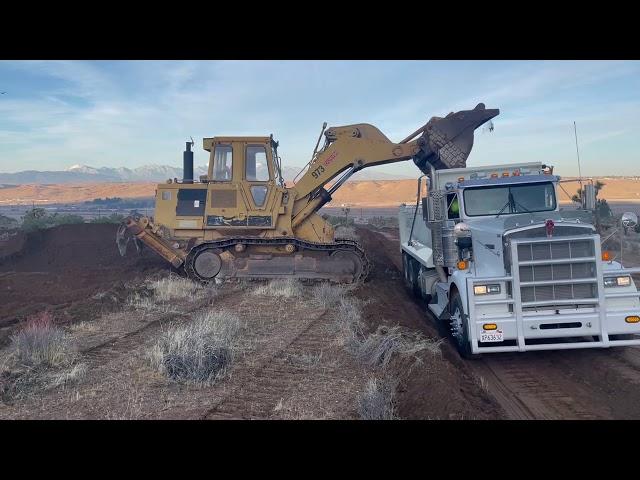 4G - CAT 973 Track Loader Operator Loading Super 10 Dump Truck