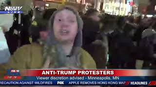ANTI-TRUMP PROTESTERS: Crowd of protesters stand outside after Trump rally in MN