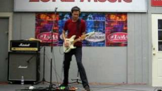 This is Paul Gilbert of Racer X Superheroes with backing tracks when he was doing a solo demonstration/gig at a local music store. This was taken on August ...