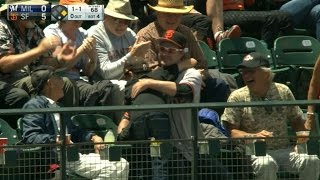 Fan gives a kid a ball, gets a hug in return