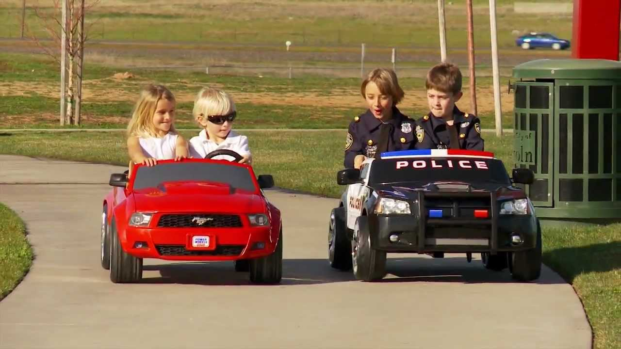 power wheels race police charger vs mustang youtube