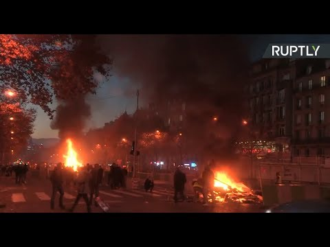 Tear gas, water cannon, smoke grenades: 'Yellow Vest' protesters rally against fuel tax in Paris