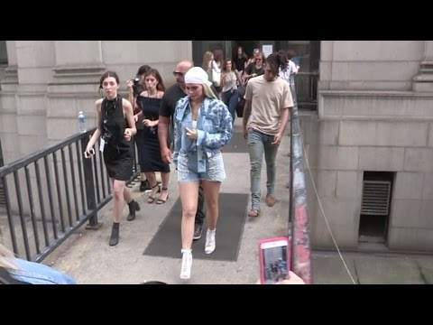 Kylie Jenner swarmed by fans as she gets out of the Jonathan Simkhai Fashion Show in New York City