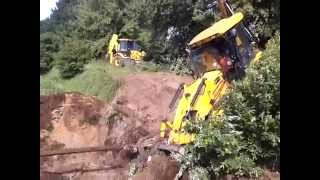CAT vs JCB accident in channel