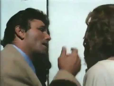 Peter Falk and Jill Clayburgh sneak into a movie theatre...