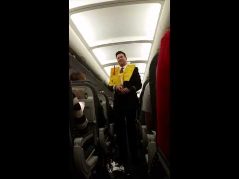 United Airlines Flight Attendant Can't Stop Laughi