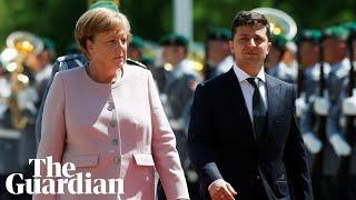 Angela Merkel shakes during national anthem, blaming dehydration