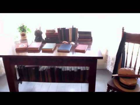 Braided rugs and books at Hamlin Garland homestead West Sal