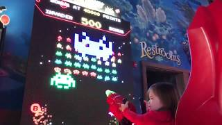 Two-Year-Old Arcade Player Refuses to Give Up on Space Invaders