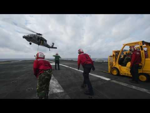 Black Knights Helicopter delivering ammunition on USS Carl Vinson CVN 70