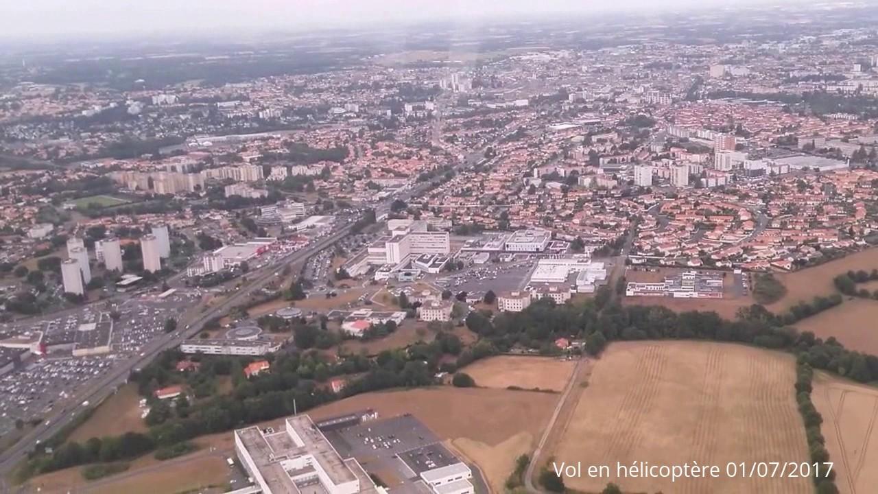 Vol en hélicoptère autour de la ville de Cholet (49) - YouTube