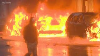 Looters damage downtown Seattle stores, set fire to police cars