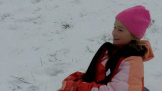 Hannah Brown sledding down the Mansker Farms hill Thumbnail