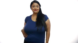 Portrait of an Indian overweight woman posing for the camera - White background. Health concept