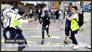 Hong Kong protester shot in street confrontation with police