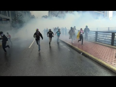 Police use tear gas to disperse opposition march in Caracas