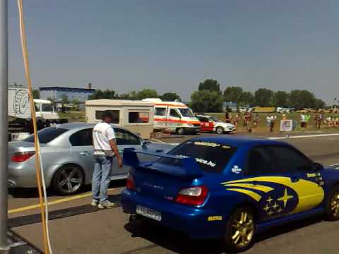 BMW M5 VS SUBARU WRX STI (1)