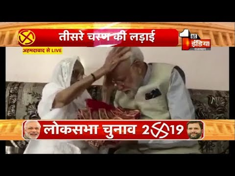 PM Modi seeks blessing from mother before casting his vote