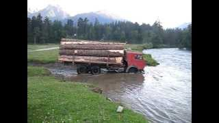 Камаз ворует древесину из заповедника (Архыз)(Smuggling of timber in russian nature reserve. A truck crosses mountain river..., 2011-11-16T18:37:09.000Z)