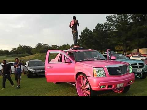 John Standing on top of his Escalade at Battle Of The Whipz