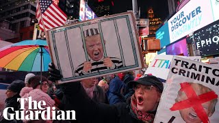 Trump impeachment: protesters gather in Times Square on eve of vote