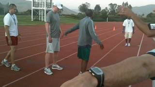 Coach Smith Talks Mile Relay Exchanges...