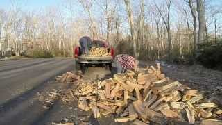 Loading Firewood Into Truck Timelapse