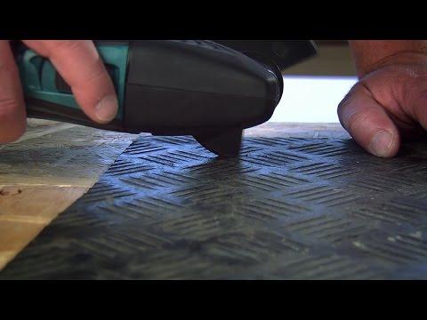 Met de multitool rubber vinyl en bijvoorbeeld tapijt snijden