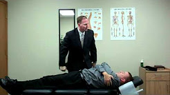 Chiropractor Bloomington IL performs Mid Back Pain Adjustmen